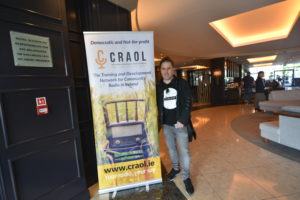 Colin Fahy with the Craol Banner at his side.